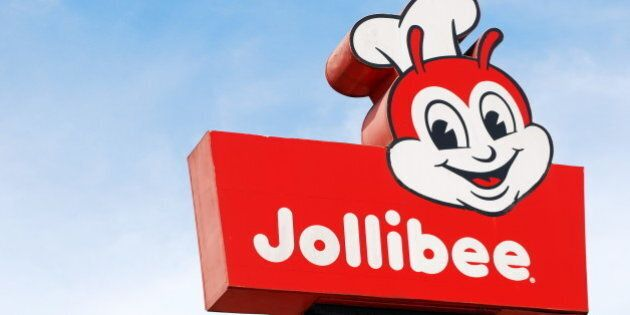 A shot on an elevated signage of Jollibee fastfood in Tagaytay.Jollibee is a popular Mcdonalds-like fastfood chain in the Philippines.==On our way to May and Glenn's wedding at Tagaytay Highlands.