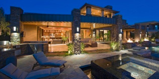 House exterior lit up at night, with patio