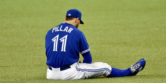 Toronto Blue Jays center fielder Kevin Pillar sits on the turf after hurting himself while trying to field a ball in the eighth inning against the Kansas City Royals during Game 4 of the ALCS on Tuesday, Oct. 20, 2015, at Rogers Centre in Toronto. (Jill Toyoshiba/Kansas City Star/TNS via Getty Images)