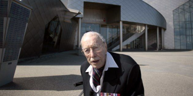 TO GO WITH AFP STORY BY ANNE MEYER 101 years old canadian veteran Ernest Cote poses in front of the Juno...