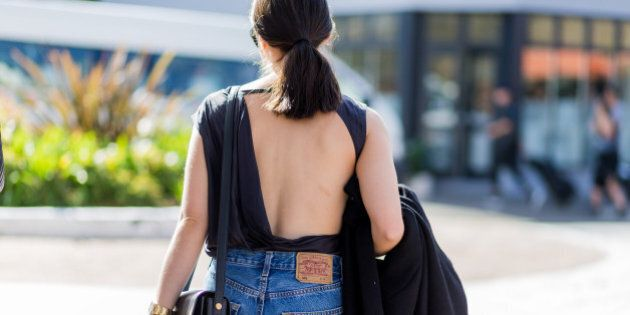 SYDNEY, AUSTRALIA - MAY 16: A guest wearing a backless top and Levis jeans outside Yeojin Bae at Mercedes-Benz Fashion Week Resort 17 Collections at Carriageworks on May 16, 2016 in Sydney, Australia.   (Photo by Christian Vierig/WireImage)