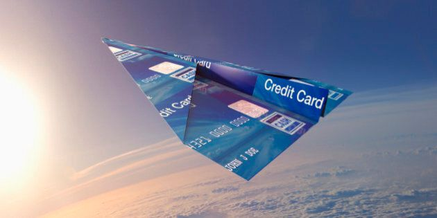 Credit card folded into paper airplane in