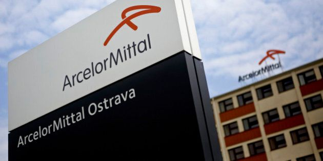 A logo sits on a sign outside the entrance to the ArcelorMittal steel plant in Ostrava, Czech Republic,...