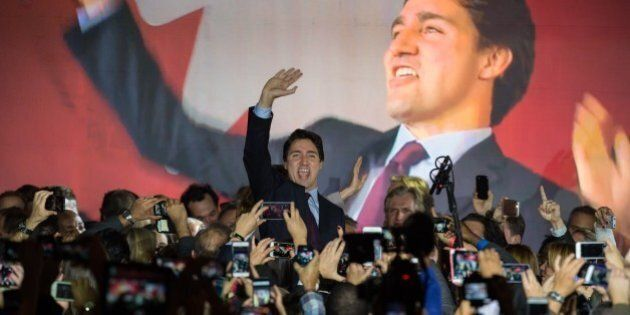 Canadian Liberal Party leader Justin Trudeau arrives on stage in Montreal on October 20, 2015 after winning...