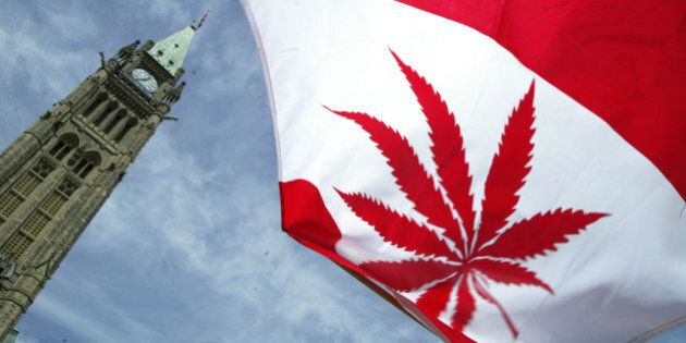OTTAWA, ON - JUNE 5: A Canadian flag with a marijuana leaf flies during a rally in support of legalizing...