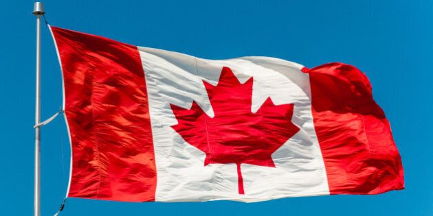 canadian flag waving in the air ...