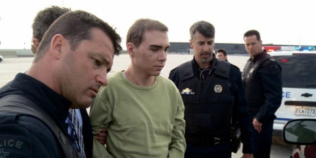 FILE - In this Monday, June 18, 2012 file photo provided by Montreal Police, Luka Rocco Magnotta is taken...