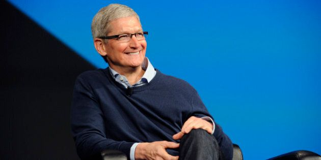 Tim Cook, chief executive officer of Apple Inc., smiles during the BoxWorks 2015 Conference at the Moscone...