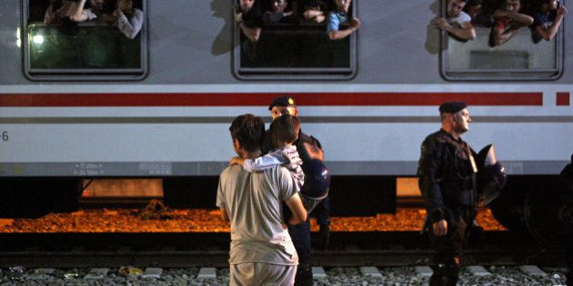 TOVARNIK, CROATIA - SEPTEMBER 17: A syrian refugee with his child wait to board a train in the eastern-Croatia...