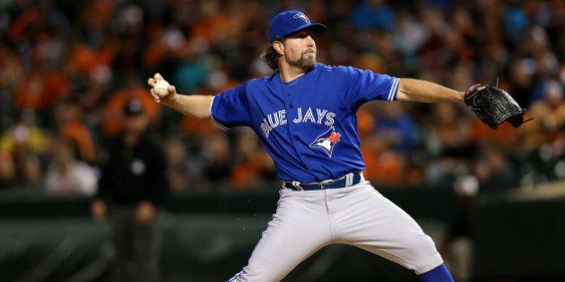 BALTIMORE, MD - SEPTEMBER 30: Starting pitcher R.A. Dickey #43 of the Toronto Blue Jays works the third...