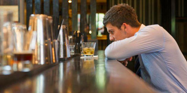 Lonely Hispanic businessman sitting at