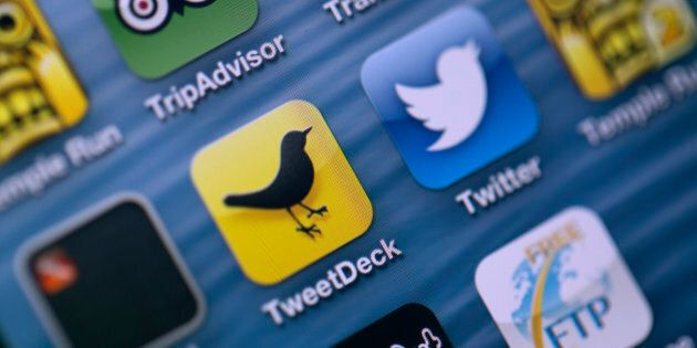 Logos for Twitter Inc.'s TweetDeck app, center left, and Twitter app, center right, are seen on the screen...