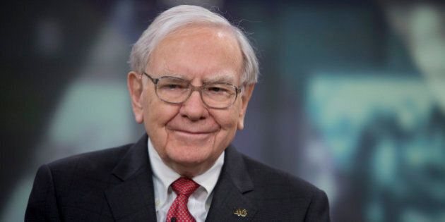 Warren Buffett, chairman and chief executive officer of Berkshire Hathaway Inc., smiles during an interview...