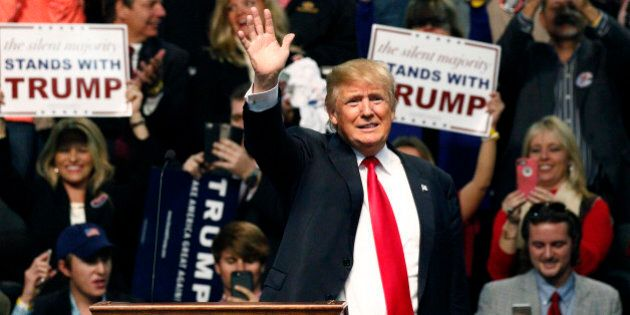 Republican presidential candidate Donald Trump waves during a rally in Biloxi, Miss., Saturday, Jan....
