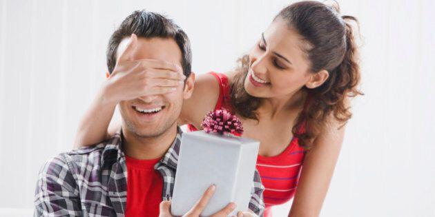 Woman giving present to man
