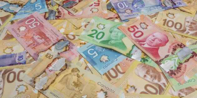 Canadian dollar bills spread