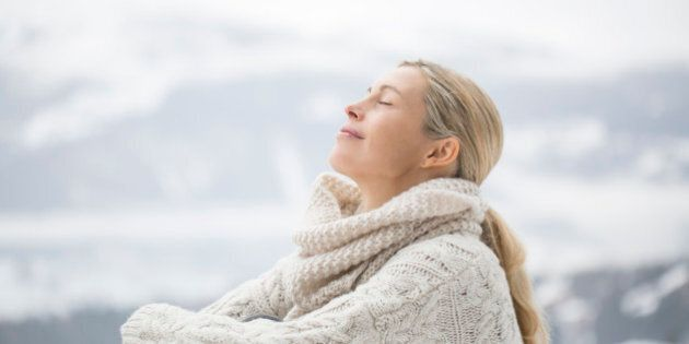 Close-up of a woman sitting with her eyes closed, Crans-Montana, Swiss Alps,