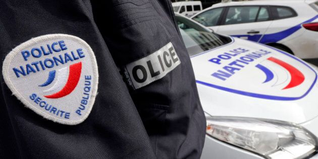 An illustration picture shows a French National Police insignia on the uniform of an officer who stands...