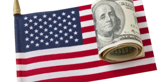 Miniature version of American Flag and roll of american hundred dollars