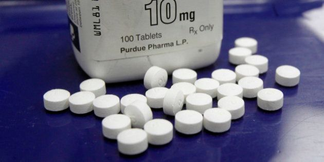 FILE - This Feb. 19, 2013, file photo, shows OxyContin pills arranged for a photo at a pharmacy in Montpelier,...
