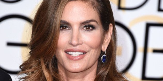 BEVERLY HILLS, CA - JANUARY 11: Cindy Crawford arrives at the 72nd Annual Golden Globe Awards at The...