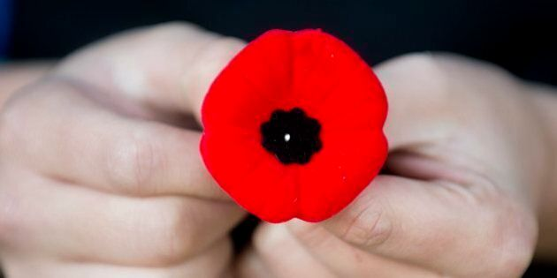 A poppy is the traditional symbol of remembrance in Canada and other countries in the British