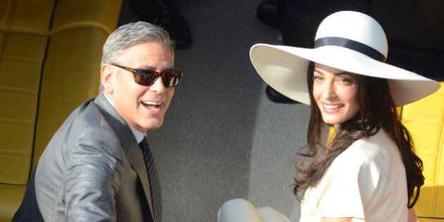 George Clooney and his wife Amal Alamuddin leave the city hall after their civil marriage ceremony in...