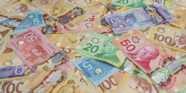 Canadian dollar bills spread