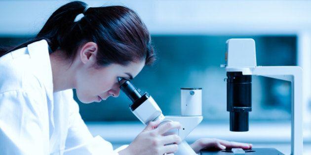 scientist using a microscope in ...