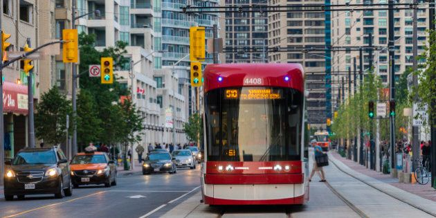 TORONTO, ONTARIO, CANADA - 2015/07/01: New Toronto street cars Flexity Outlook in evening street. City...