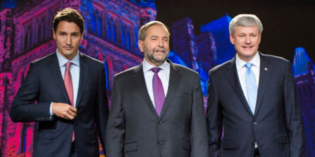 Justin Trudeau, leader of the Liberal Party of Canada, from left, Thomas 'Tom' Mulcair, leader of the...