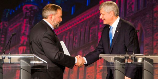 Thomas 'Tom' Mulcair, leader of the New Democratic Party, left, shakes hands with Conservative Leader Stephen Harper, Canada's prime minister, following the second leaders' debate in Calgary, Alberta, Canada, on Thursday, Sept. 17, 2015. The debate pits Harper and his Conservative Party's program of tax cuts and spending restraint against the Liberal Party's Justin Trudeau, who is pledging to raise taxes on the highest earners, and Mulcair, who advocates increasing levies on corporations. Photographer: Ben Nelms/Bloomberg via Getty Images