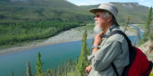 David looks over the Hart River valley on one of the many hikes into the alpine. Juri
