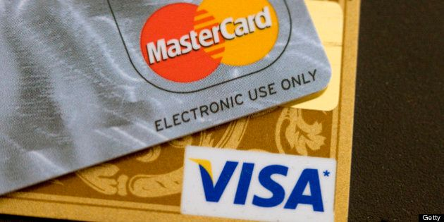 CANADA - MAY 21: Visa and MasterCard credit cards are arranged for a photo in Toronto, Ontario, Canada,...
