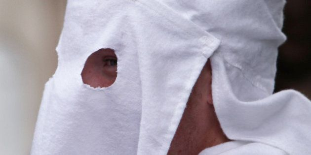 PULASKI, TN - JULY 11: A member of the Fraternal White Knights of the Ku Klux Klan participates in the 11th Annual Nathan Bedford Forrest Birthday march July 11, 2009 in Pulaski, Tennessee. With a poor economy and the first African-American president in office, there has been a rise in extremist activity in many parts of America. According to the Southern Poverty Law Center in 2008 the number of hate groups rose to 926, up 4 percent from 2007, and 54 percent since 2000. Nathan Bedford Forrest was a lieutenant general in the Confederate Army during the American Civil War and played a role in the postwar establishment of the first Ku Klux Klan organization opposing the reconstruction era in the South. (Photo by Spencer Platt/Getty Images)