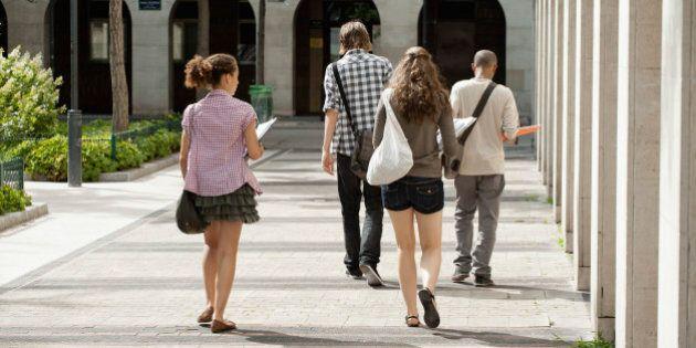 University students walking on campus, rear
