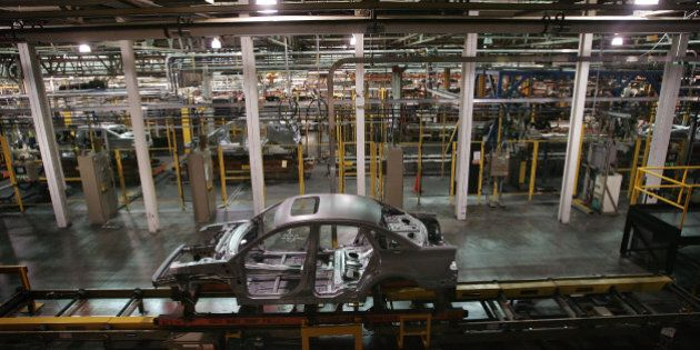 CHICAGO - JUNE 22: A Ford vehicle during the early phases of construction rides along the assembly line...