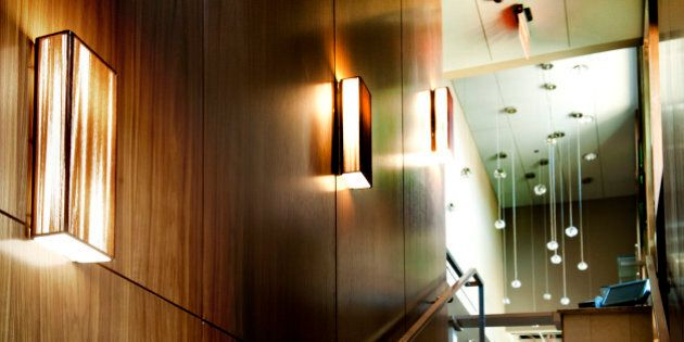 Washington, DC - March, 27: Art glass sconces mounted on wooden walls in a staircase leading up to the...