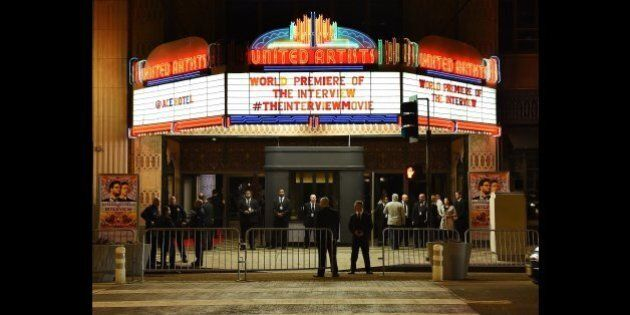 Security is seen outside The Theatre at Ace Hotel before the premiere of the film 'The Interview' in...