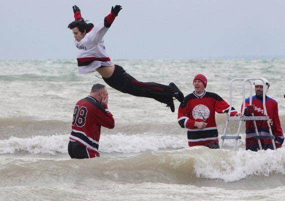 Annual 'Polar Bear Swim' Draws Thousands Across