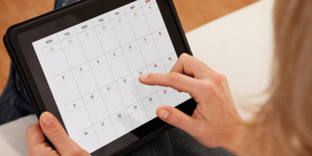 USA, Illinois, Metamora, Close-up of woman using calendar on digital