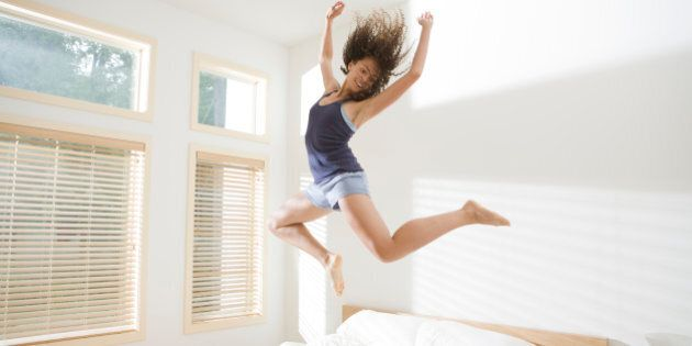 Attractive Young Woman Jumping Energetically on