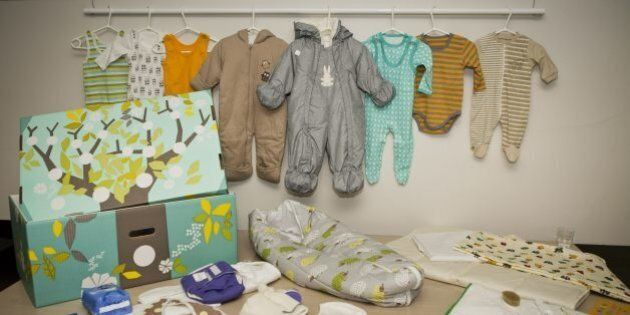 This photo taken on Aug. 15, 2012 shows the contents of the Finnish baby box, in Helsinki, Finland. Finland's...