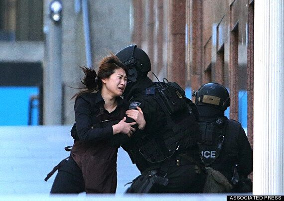 Sydney Hostages Run From Gunman
