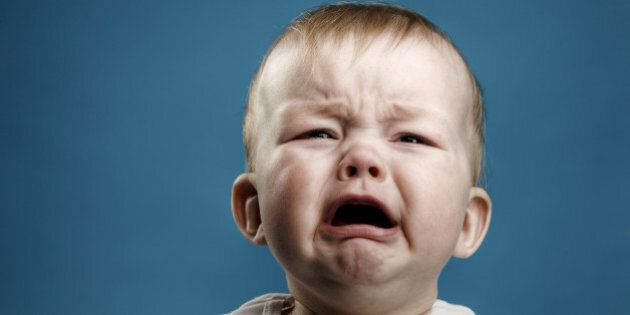 Photo of nine month baby crying,