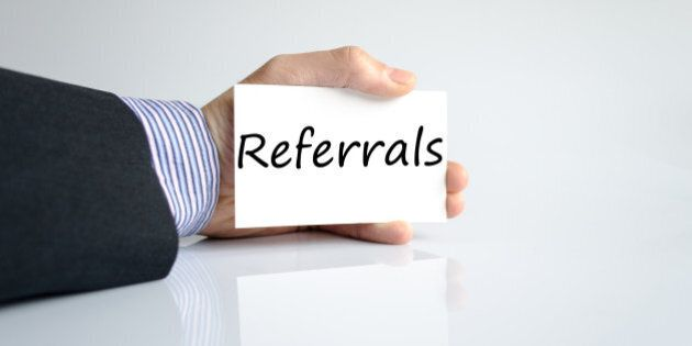 Bussines man hand writing Referrals