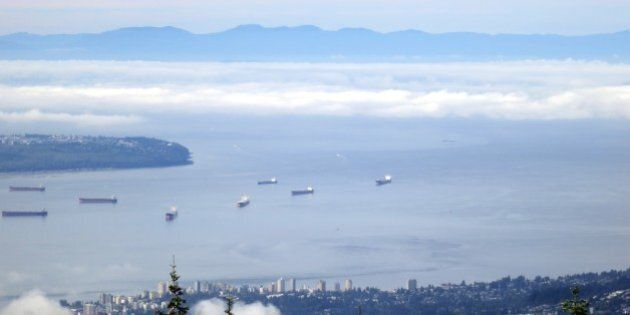 View from Grouse Mountain, showing North Vancouver in the foreground, then freighters moored in English...