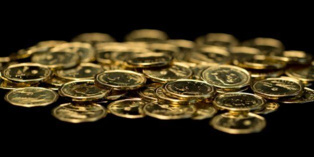 Pile of Canadian one dollar coins. The Canadian one dollar coin, commonly called the 'loonie', is a gold-coloured...