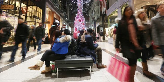 TORONTO, ON - DECEMBER 22:  Shoppers rush about a busy Eaton Centre making purchases and enjoying the light throughout the busy mall on the last Saturday of shopping before Christmas  in Toronto.  December 22, 2012  STEVE RUSSELL/TORONTO STAR        (Steve Russell/Toronto Star via Getty Images)