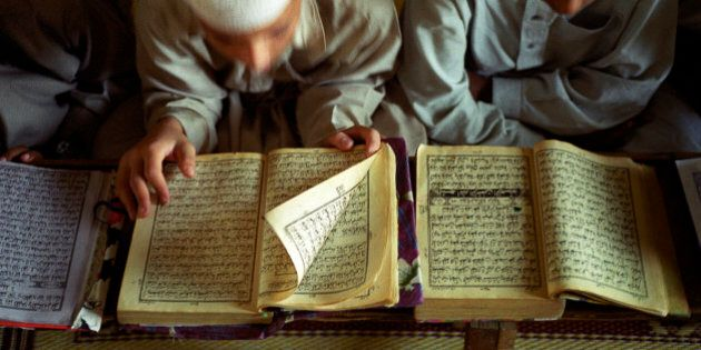 Unidentified young boys read the Koran at a Madrasa Qur'an school on September 24, 2001 in Rawalpindi...